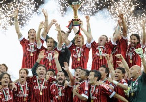 AC Milan players hold the Scudetto troph